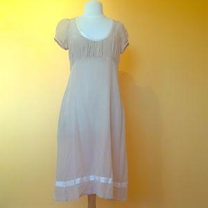 Dresses & Skirts - Champagne 100% Silk dress with cream trim.